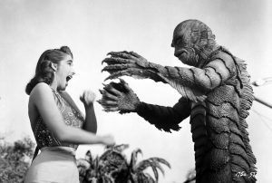 "The Academy of Motion Picture Arts and Sciences will host a month-long series of screenings of classic horror films with ""Universal's Legacy of Horror"" in October.  The series is part of the studio's year-long 100th anniversary celebration engaging Universal's fans and all movie lovers in the art of moviemaking. Pictured: Julie Adams and the Gill Man in CREATURE FROM THE BLACK LAGOON, 1954."